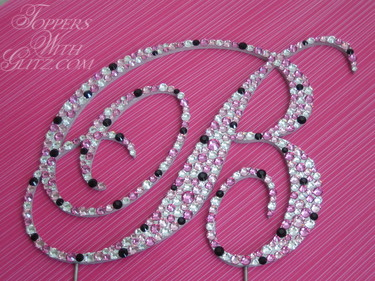 Crystal monogram cake topper using Rose, Light Rose, Crystal and Jet